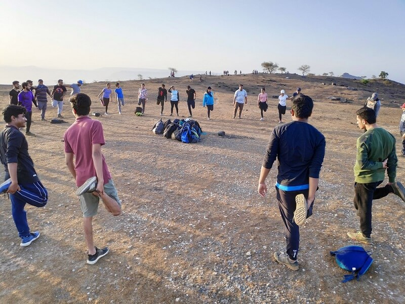 Trekkers Doing Exercise on Garbett Plateau Matheran