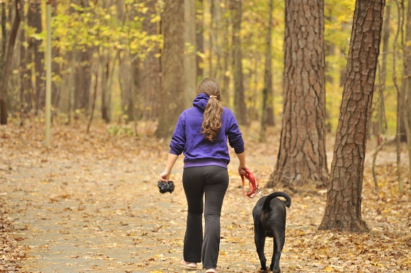 Girl Hiking with leashed Dog